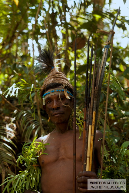 They often carry very large and strong bows and arrow as they hunt crocodile with them.