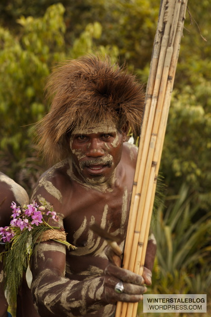 The, ahem, 'Teddyboy Tribe'. Actually this man has a juvenile cassowary skin fashioned into a hat - it just looks uncannily like a 'bad hair day'.