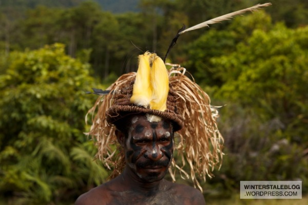 This man has the plumage of a 'twelve wired bird of paradise' adorning his hat.